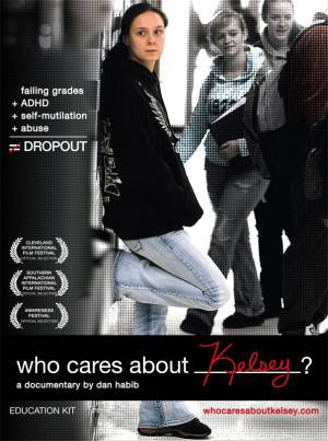 "Image description: Who Cares About Kelsey DVD Cover. Photograph of light skinned girl with brown hair wearing a black sweatshirt and jeans, leaning up against a locker, turned to the side face looking to her right. Students in the hall in the background. Text reads Failing grades + ADHD + Self mutilation + Abuse white equal sign with red slash indicating ""not equal"". Dropout. Festival Awards listed on left side of screen."