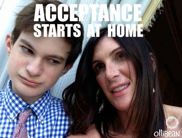 """Acceptance starts at home"" Photograph of teenage boy with white skin and brown hair with woman with white skin and dark brown shoulder length hair"