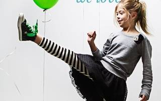 Photo of girl kicking with balloons in background. Text reads: RESOURCES we love. Ollibean logo.