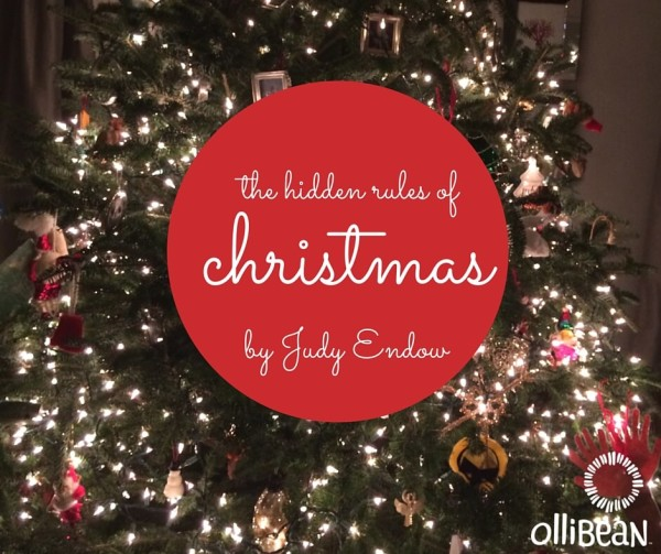 "Photo of Christmas tree. Red Circle in middle with "" The Hidden Rules of Christmas by Judy Endow on Ollibean """